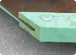 Wrap-around mixer drum blade liner tips