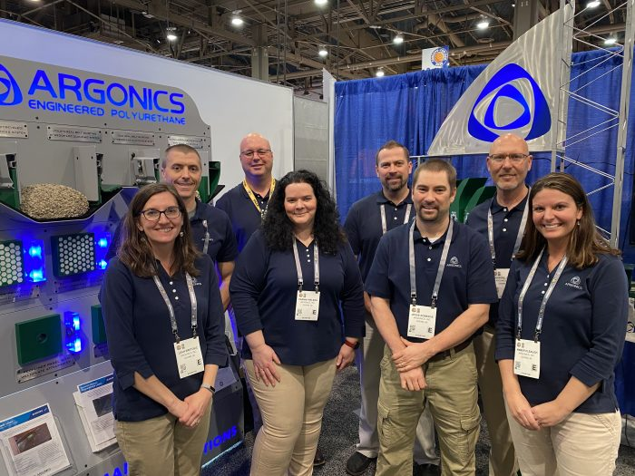 Argonics staff at trade show booth in Las Vegas